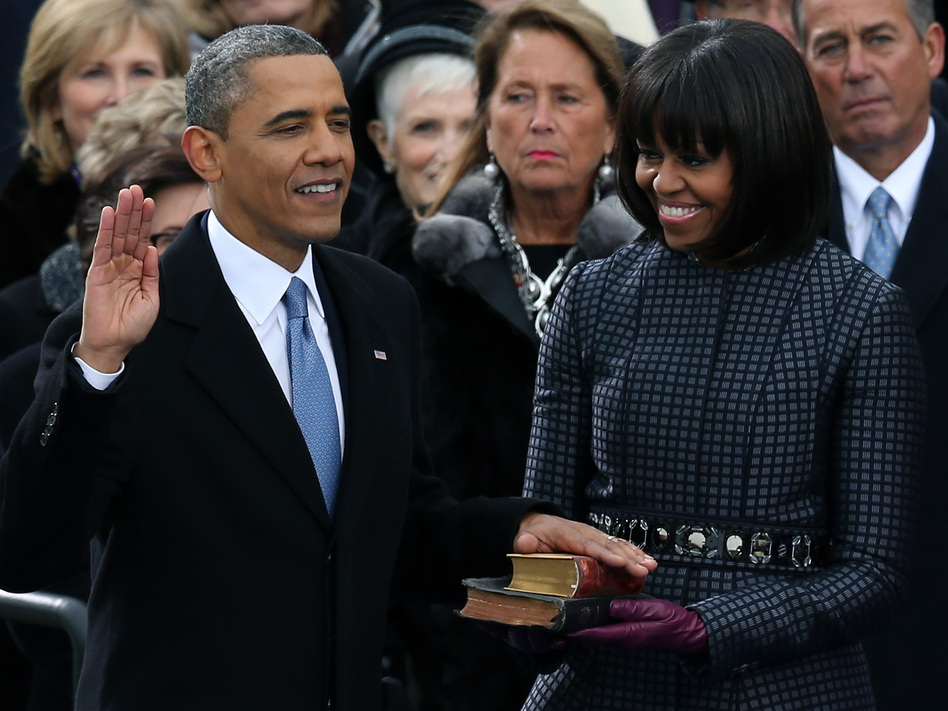 President Obama taking the oath of office today on the steps of the Capitol. First Lady Michelle Obama held the two Bibles on which he placed his hand.