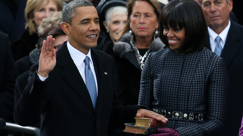 President Obama taking the oath of office today on the steps of the Capitol. First Lady Michelle Obama held the two Bibles on which he placed his hand. (Getty Images)
