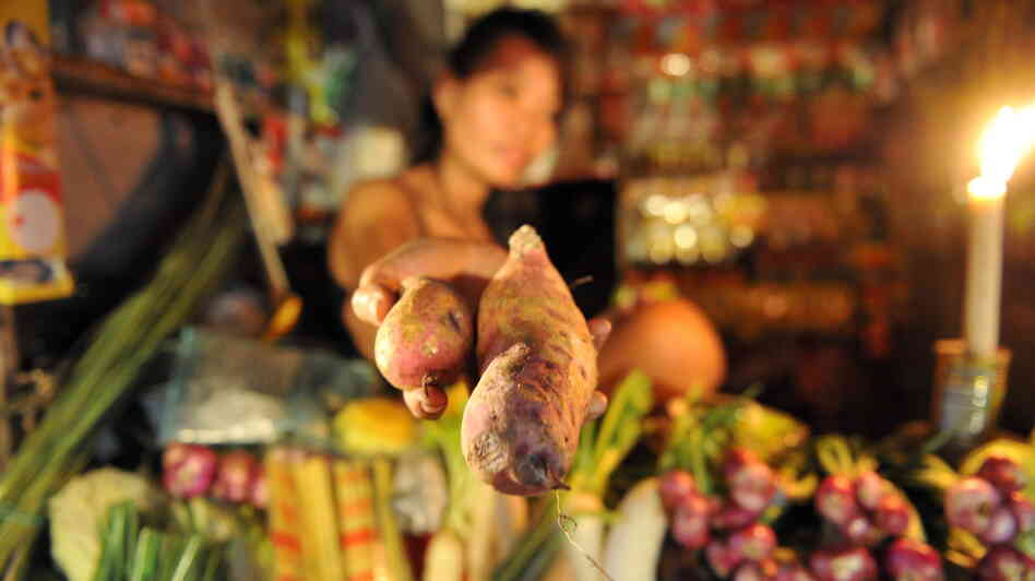A well-traveled root: A vendor sells sweet potatoes at a market near Manila in 2011. The Portuguese brought the root to the Philippines all the way from the Caribbean.