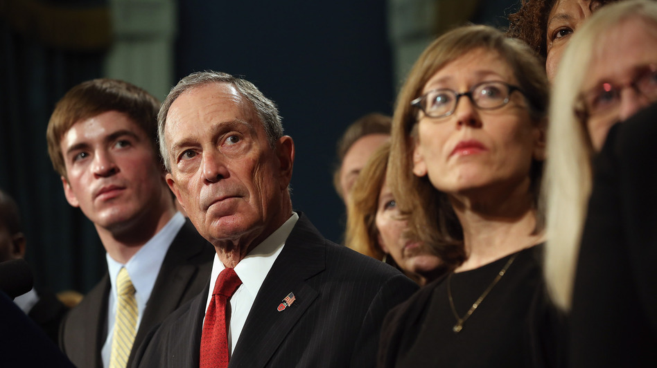 At a news conference last month, New York City Mayor Michael Bloomberg stands with people who have been affected by gun violence. (Getty Images)