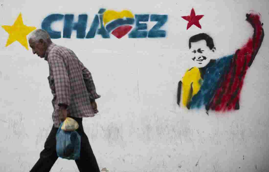 A man walks past a mural of Venezuelan President Hugo Chavez in Caracas, on Jan. 11.