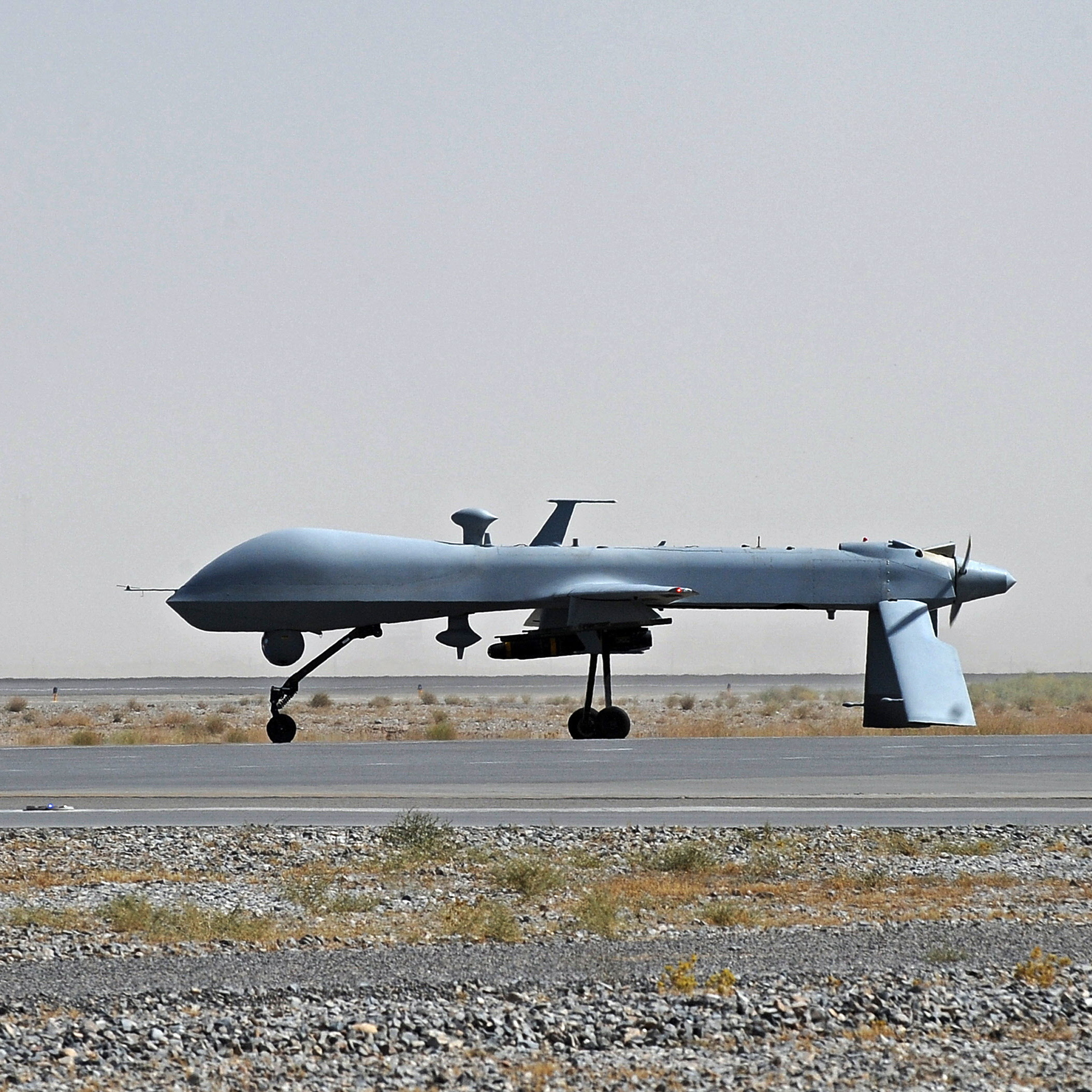 An unmanned U.S. Predator drone sat on the tarmac of Kandahar military airport in southern Afghanistan in 2010. Drone strikes have increased markedly on Obama's watch.