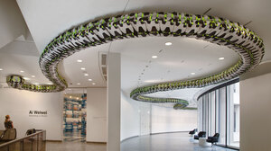 """Ai Weiwei's Snake Ceiling, a serpentine form made from children's backpacks, is currently on display at the Hirshhorn Museum's """"According to What?"""" exhibit. It commemorates the thousands of students who died in poorly constructed schools during the 2008 Sichuan earthquake."""