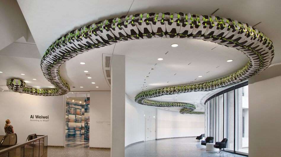 "Ai Weiwei's Snake Ceiling, a serpentine form made from children's backpacks, is currently on display at the Hirshhorn Museum's ""According to What?"" exhibit. It commemorates the thousands of students who died in poorly constructed schools during the 2008 Sichuan earthquake. (Courtesy Hirshhorn Museum)"