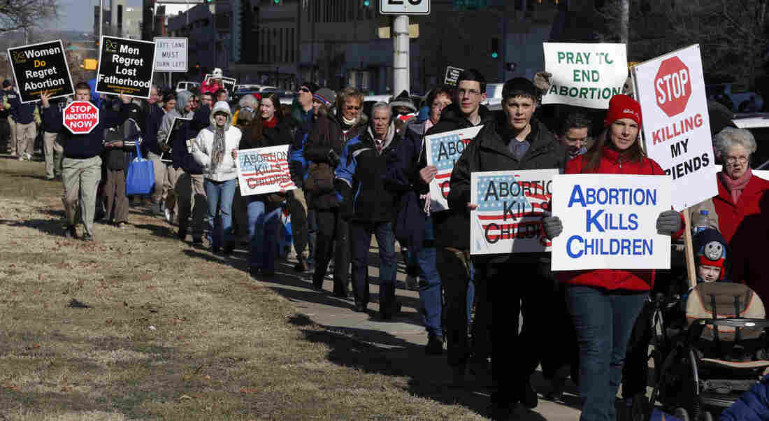 Abortion opponents march to a rally at the Kansas Statehouse in Topeka, Kan., on the 40th anniversary of Roe v. Wade. Kansas is among several states that have enacted new restrictions on abortion in recent years.