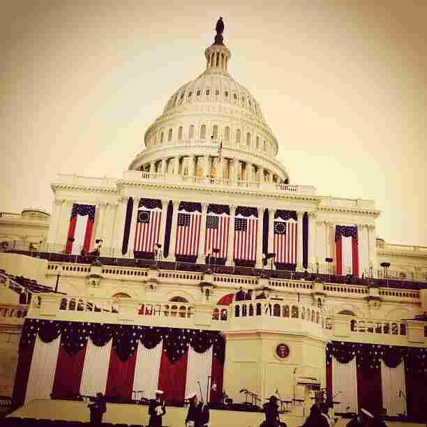 "An Instagram photo from White House Correspondent Ari Shapiro shows the U.S. Capitol draped in flags on inauguration morning. Shapiro's caption: ""Sun rising over the dome. Earlybird filter seems appropriate."""