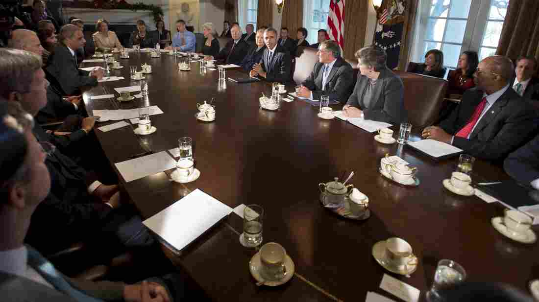 President Barack Obama, center, makes a statement to the media before the start of a meeting with his Cabinet on Nov. 28, 2012.