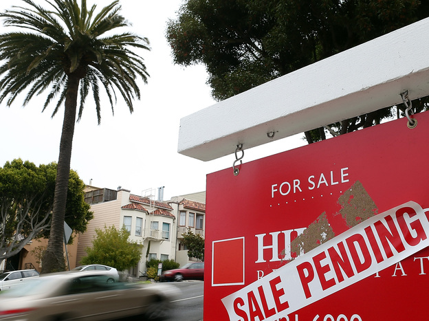"""A """"sale pending"""" sign outside a home in San Francisco last August."""