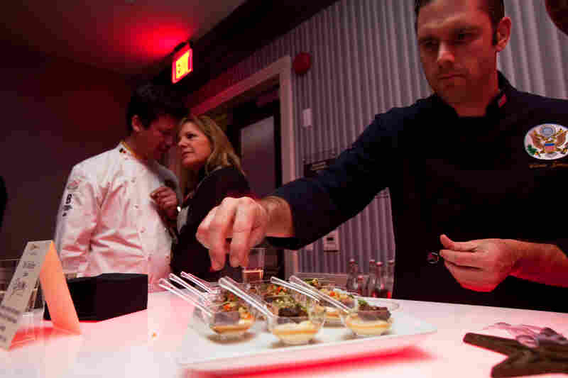 "Christopher James, the State Department's deputy chef, helps plate the offerings at the Chefs Ball on Saturday, Jan. 19. The Chefs Ball was hosted by Art Smith, who decried the offerings of most balls, saying, ""usually, there's just bad food or no food at all. Here, we want the food to be the focus and inspiration."" Proceeds from the night went to charities."