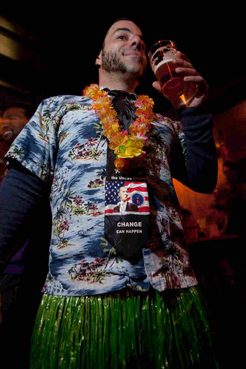 Nahem Simon, beer director at Jack Rose, gets into the spirit at the luau.