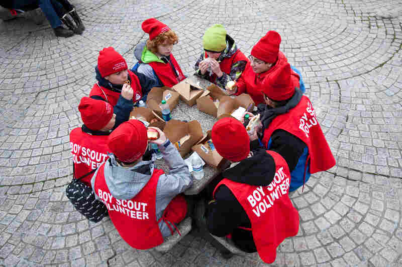 Members of New Jersey Boy Scout Troop 201, in town to help volunteer at the Inauguration Parade, take a boxed lunch break shortly before the president was sworn in for a second term.
