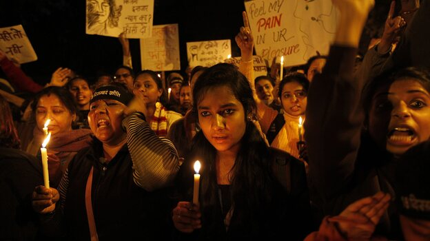 The scene at a candle light vigil earlier this month in New Delhi. Those gathered want the men accused in a brutal rape and murder to be punished, and they want violence against women in India to stop. (EPA /LANDOV)