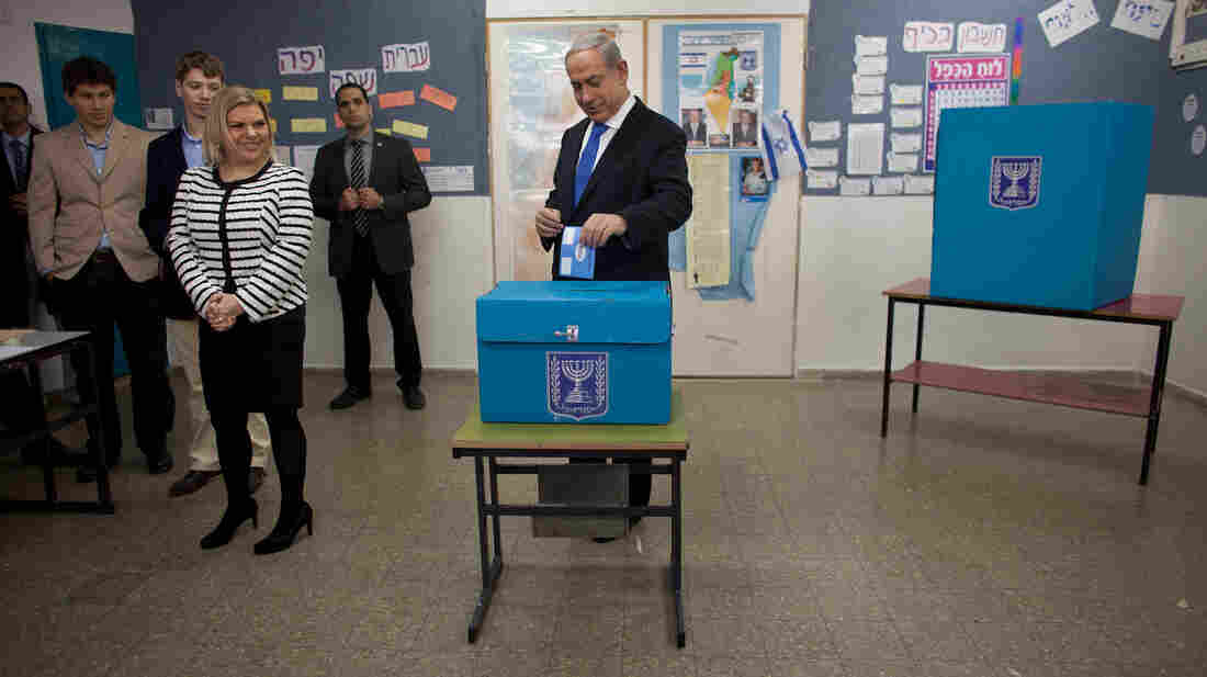 Israeli Prime Minister Benjamin Netanyahu, accompanied by his wife and sons, casts his ballot in Jerusalem on Tuesday as part of parliamentary elections. Netanyahu is expected to remain in power.