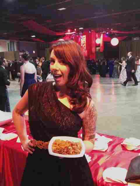 "Veterans Affairs blogger Kate Hoit shows off her ""fancy"" pretzels and cheese crackers at the official inaugural ball Monday night."