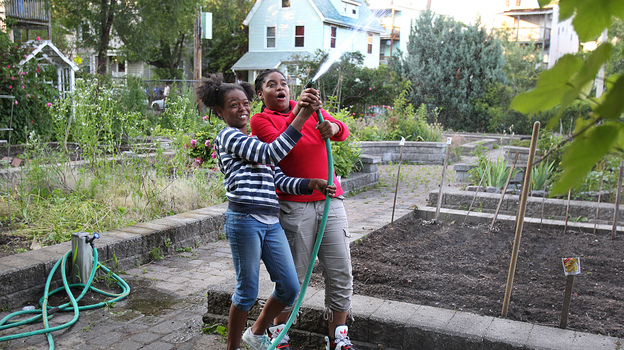 Best friends Kaori Tate and Ghiyahna Ennis explore their plot in the community garden. (The Boston Globe)