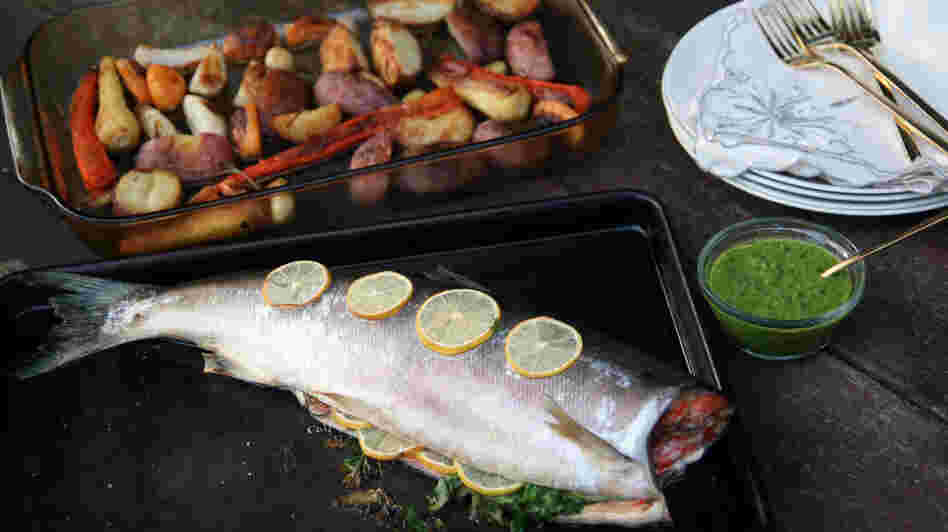 "This version of the ""Sunday roast"" features salmon with salsa verde and oven-browned vegetables."