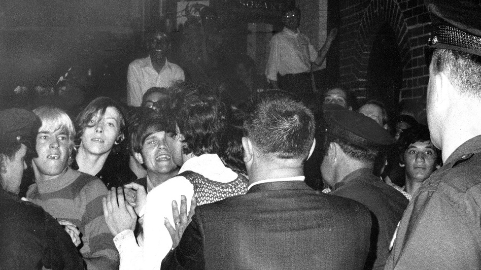 The crowd faces off with police at the Stonewall Inn nightclub raid in the summer of 1969 in New York City. (NY Daily News via Getty Images)