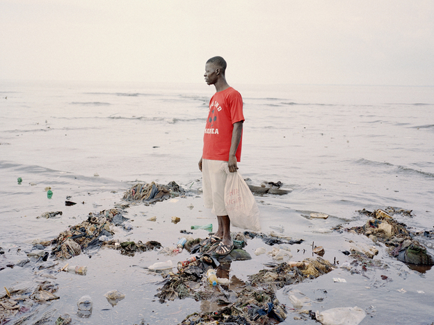 Momoh, 33, collects plastic bottles from the polluted beach of Kroo Bay, a poor slum settlement of 5,500 people in Freetown, Sierra Leone. In 2012, Sierra Leone suffered through one of its worst outbreaks of cholera, a waterborne disease that infects the intestine and is transmitted through contaminated water and food. The disease has ravaged 12 of the country's 13 districts.