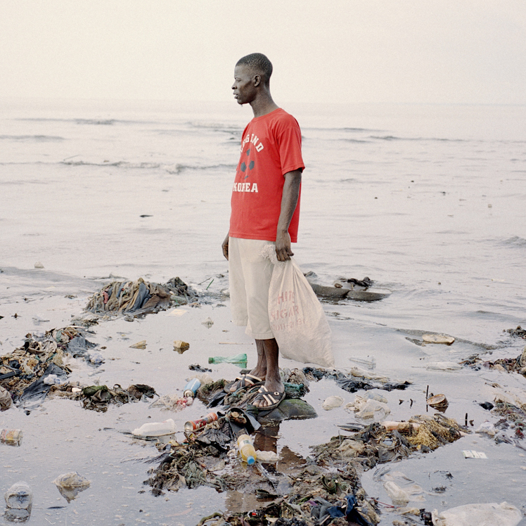 Momoh, 33, collects plastic bottles from the polluted beach of Kroo Bay, a poor slum settlement of 5,500 people in Freetown, Sierra Leone. In 2012, Sierra Leone suffered through one of its worst outbreaks of cholera, a waterborne disease that infects the intestine and is transmitted through contaminated water and food. It ravaged 12 of the country's 13 districts.