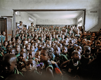 Children from Holy Trinity Primary School in east Freetown watch an educational video from the Sierra Leone Red Cross Mobile Cinema Unit, which toured the country in the aftermath of the outbreak.
