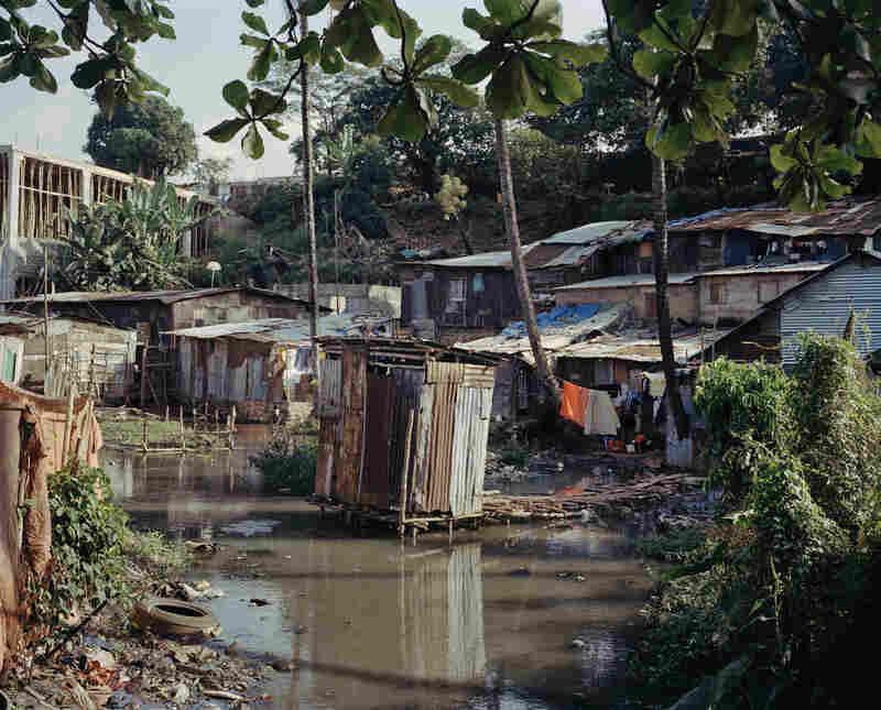 A public latrine in Freetown's Grey Bush slum where cholera struck. Open defecation is common while public bathrooms are generally in poor order and costly to use.