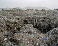 The main dumpsite in the center of Freetown where garbage and human waste has accumulated into massive caverns. While the cholera outbreak receded by the end of 2012, the danger for another outbreak remains. The core of the problem lies in an infrastructure unable to cope with a large urban population.