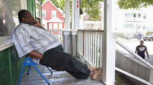 Nathaniel Davis sits on his porch a couple of days after the verdict for the murder trial of his son.