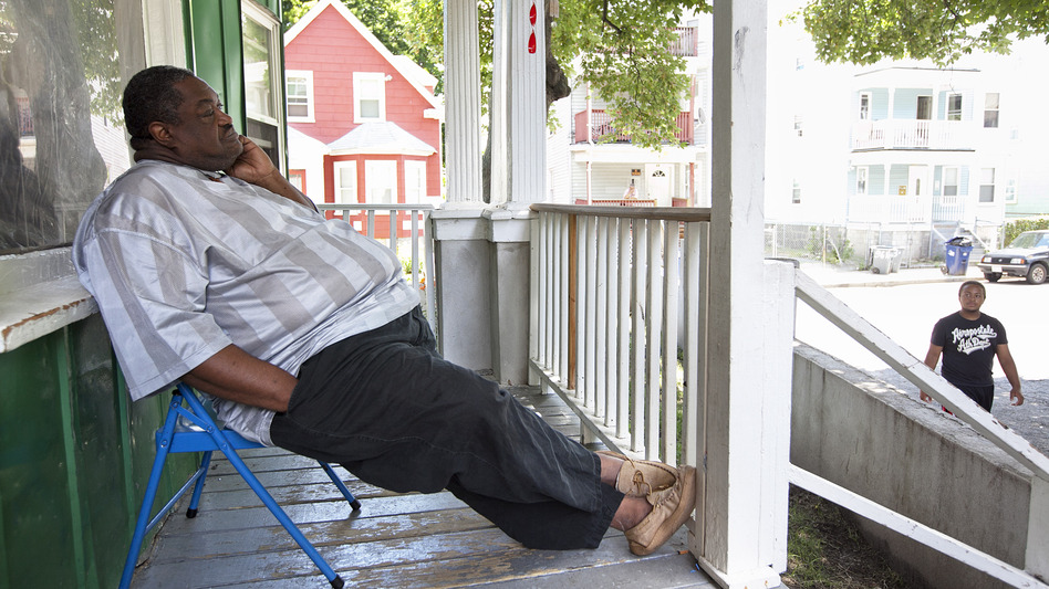 Nathaniel Davis sits on his porch a couple of days after the verdict for the murder trial of his son. (The Boston Globe)