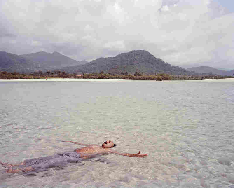 A tourist from New Delhi floats in the clean water of River Number 2, a beach 16 kilometers (about 10 miles) south of Freetown that is typically populated by tourists and aid workers.