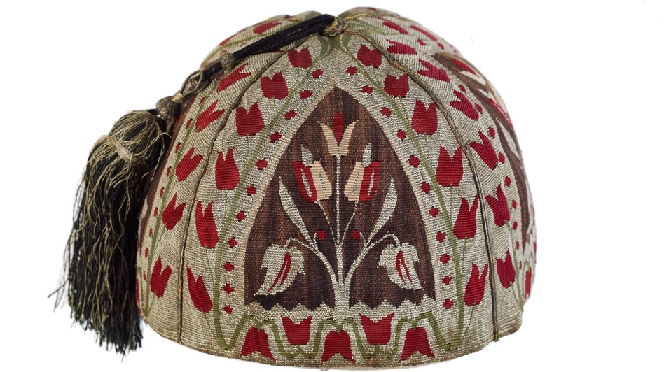 The silken tassel on this skull cap, woven in Aleppo around 1800, recalls a more prosperous and tranquil time in that now-beleaguered Syrian hub. (Courtesy of The Textile Museum)