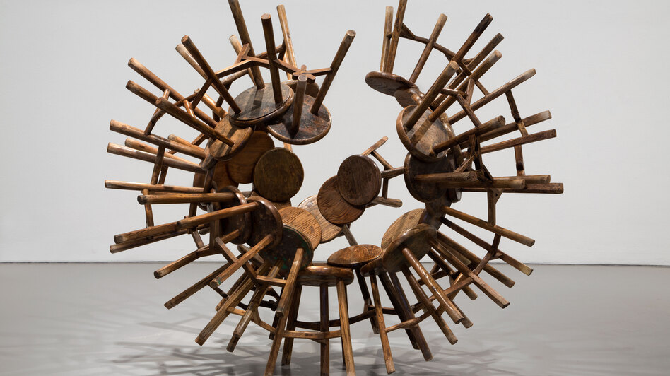 Grapes, a spiky cluster of wooden stools from the Qing Dynasty (1644-1911), is part of Ai Weiwei's repurposed furniture series. (Courtesy Hirshhorn Museum)