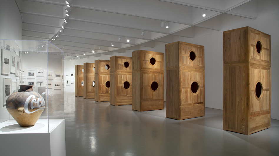 Peering through different circular holes in Moon Chest (right) reveals various stages of a lunar eclipse. It's also part of Ai's repurposed furniture series. (Courtesy Hirshhorn Museum)