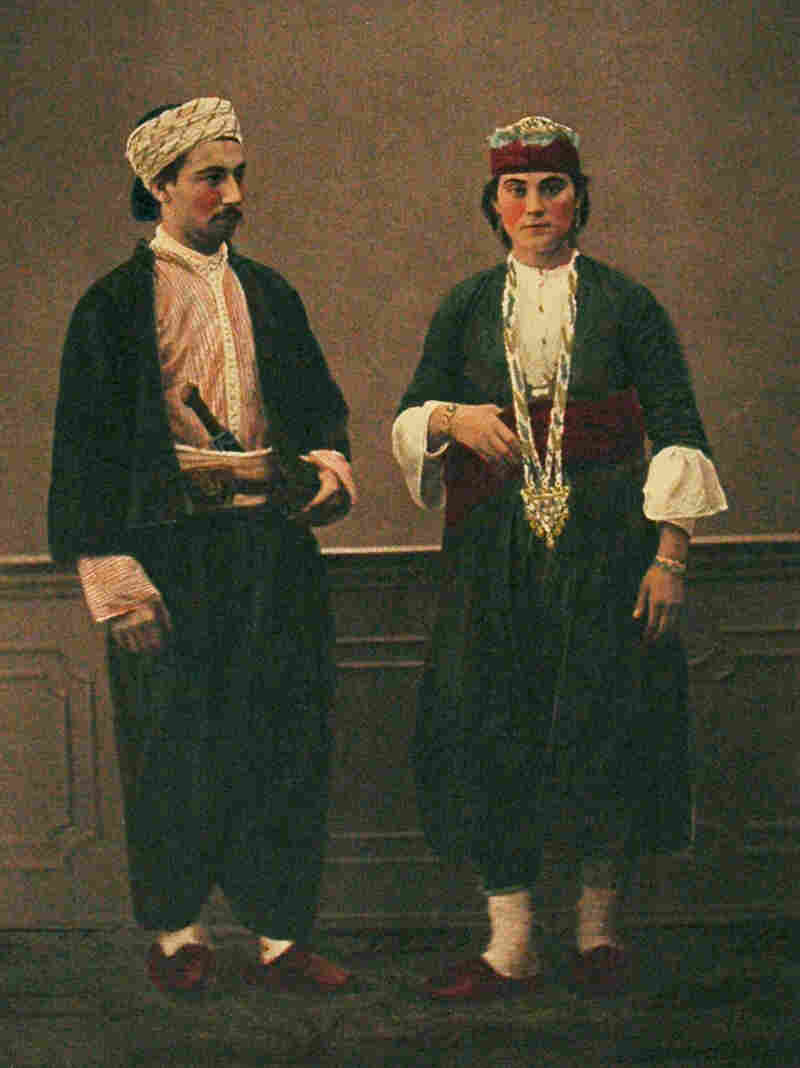 In 1800, when the tapestry cap was made, Aleppo was a major textile center, dotted with workshops where silk was woven and crafted. This 1873 photograph shows a Muslim man and woman from the region.
