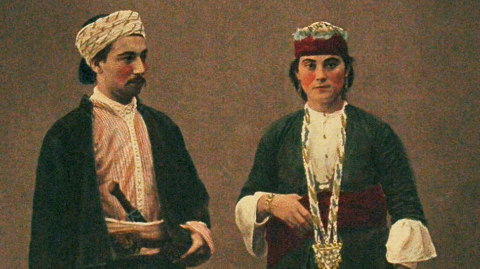 In 1800, when the tapestry cap was made, Aleppo was a major textile center, dotted with workshops where silk was woven and crafted. This 1873 photograph shows a Muslim man and woman from the region. (Courtesy of The Textile Museum)