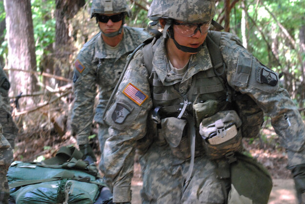 In a May 9, 2012 photo, Capt. Sara Rodriguez, 26, of the 101st Airborne Division, carries