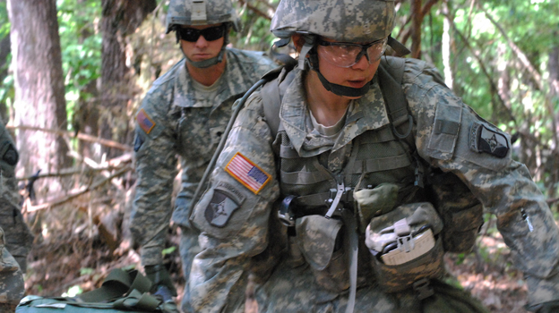In a May 9, 2012 photo, Capt. Sara Rodriguez, 26, of the 101st Airborne Division, carries a litter of sandbags during the Expert Field Medical Badge training at Fort Campbell, Ky. Female soldiers are moving into new jobs in once all-male units as the U.S. Army breaks down formal barriers in recognition of what's already happened in wars in Iraq and Afghanistan. (AP)