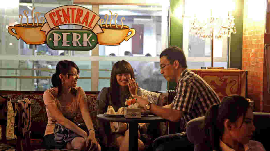Customers chat at a Beijing cafe modeled after the Central Perk cafe in the hit American sitcom Friends, in 2010. Nearly a decade after the series ended, the popularity of Friends continues among young Chinese, who use the show as a language-learning tool and enjoy its depiction of young Americans.