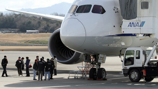 National Transportation Safety Board investigators inspect a Boeing 787 Dreamliner at Japan's Takamatsu Airport. A Federal Aviation Administration investigation into the plane's troubles has widened into a review of the agency's certification process for new airliners. (AFP/Getty Images)
