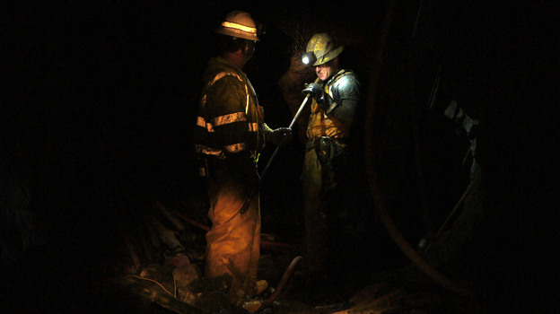 Miner Steve Ator cleans a drill bit inside the Lincoln Project Mine, in Sutter Creek, Calif. (KQED)