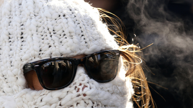 Julie Caruso of Akron, Ohio, was wrapped up Tuesday as she waited in line for a White House tour. It was well below freezing in the nation's capital. Temperatures were even lower in other parts of the nation. (Reuters /Landov)