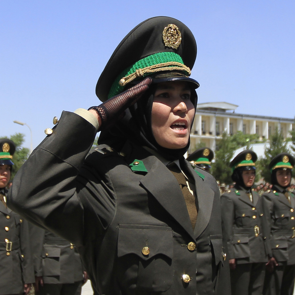 A female officer salutes during a graduation ceremony at the Kabul Military Training Center in Kabul June 13, 2012. Around 2000 Afghan soldiers and officers including 16 women graduated on Wednesday at the training center in Kabul.