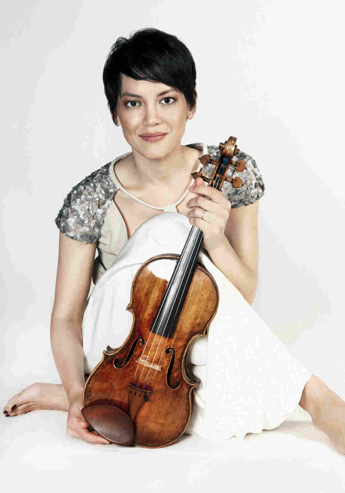 "Anne Akiko Meyers, holding the ""Vieuxtemps"" Guarneri del Gesu violin, which reportedly sold for a record price. She says the anonymous buyer has offered her use of the instrument for life."