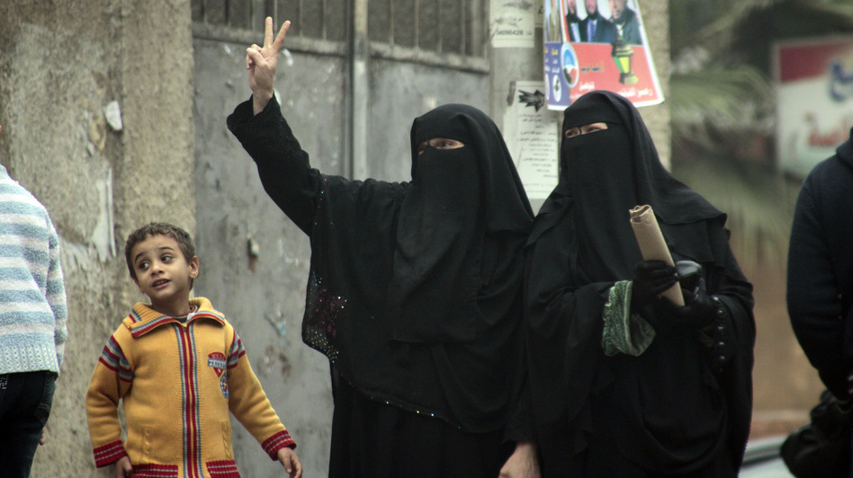 Female supporters of the Nour Party flash victory signs outside a polling station in Cairo on Jan. 30, 2012. (AP)