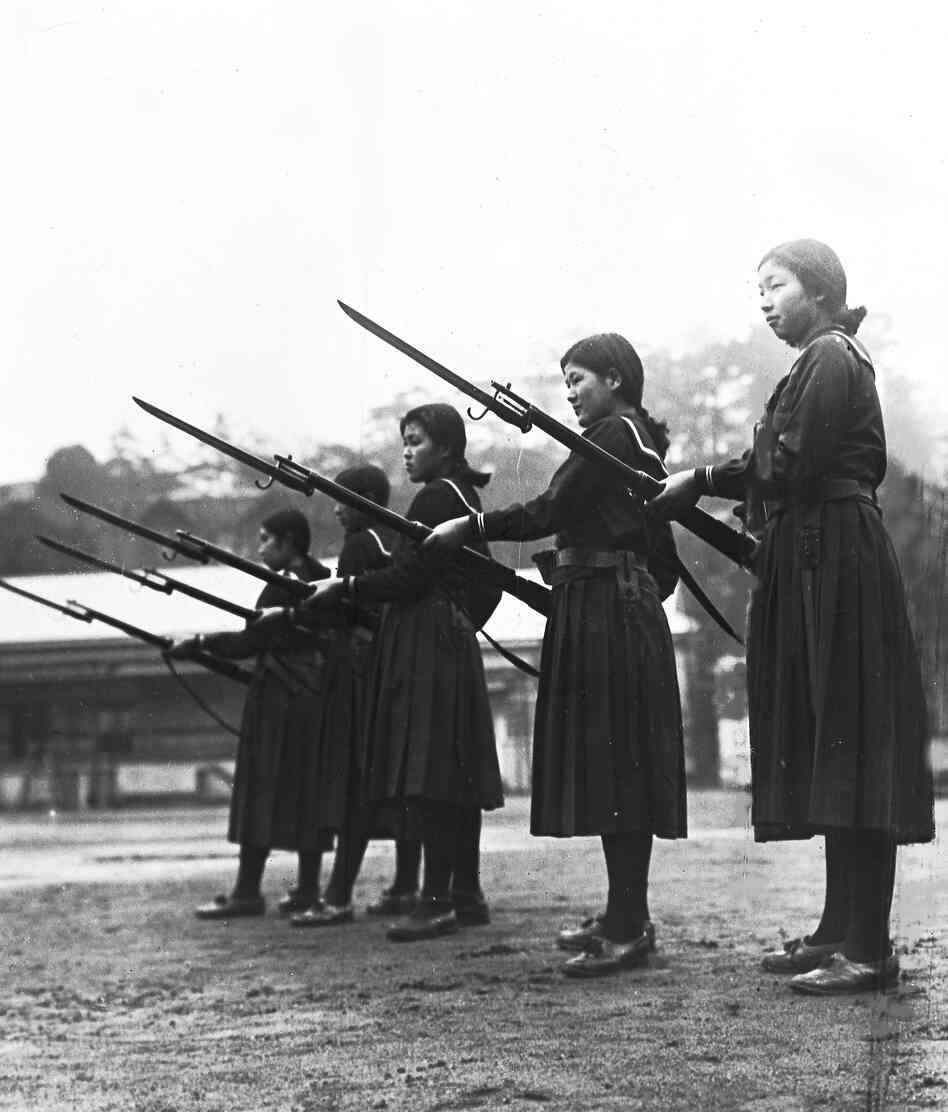 Young women learn how to charge an enemy with rifles and bayonets at their high school in Tokyo, Feb. 18, 1937. Japan trained women and girls for auxiliary army units.