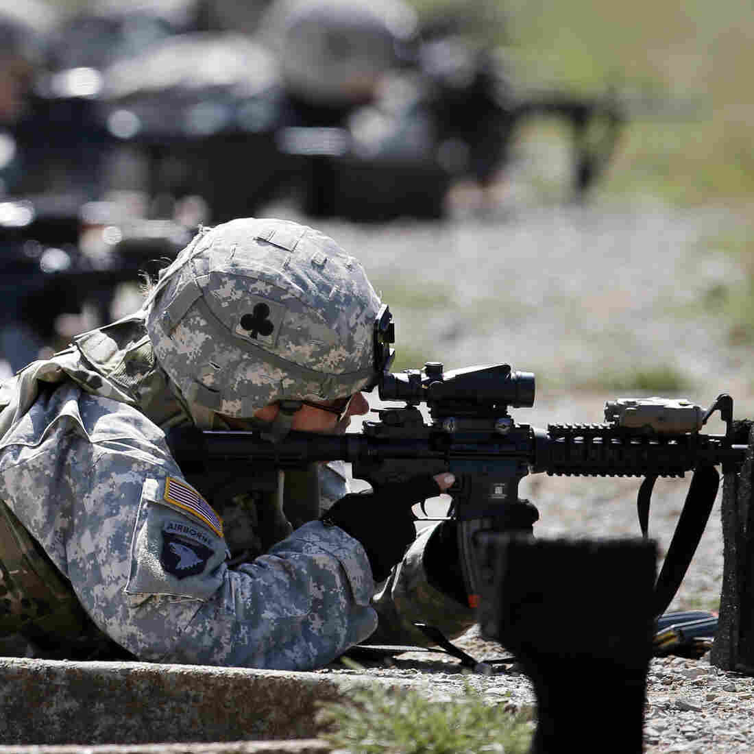 Female soldiers from 1st Brigade Combat Team, 101st Airborne Division train on a firing range in Fort Campbell, Ky., in preparation for their deployment to Afghanistan. The Pentagon announced Thursday that women will no longer be banned from combat roles.