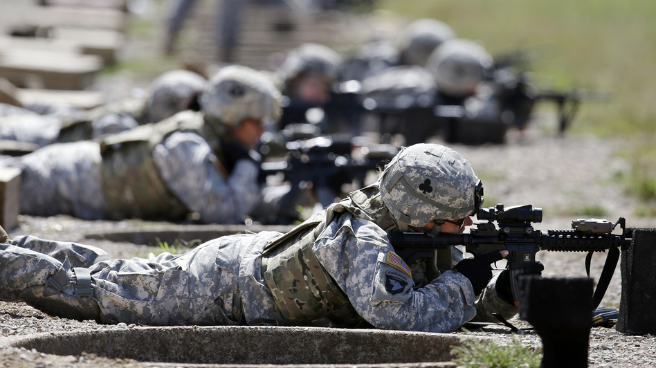 Female soldiers from 1st Brigade Combat Team, 101st Airborne Division train on a firing range in Fort Campbell, Ky., in preparation for their deployment to Afghanistan. The Pentagon announced Thursday that women will no longer be banned from combat roles. (AP)