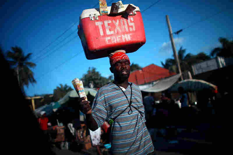 Street vendors peddle cool drinks to drivers stuck in one of the daily traffic jams on Highway 1, which is the main route out of Port-au-Prince, the Haitian capital, to the north. Traffic is one of the obstacles to tourism development in the impoverished Caribbean nation.