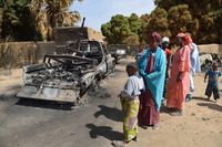 Malians gather around the remains of vehicles used by Islamist rebels that were destroyed by an earlier French airstrike, Jan. 23 in Diabaly, about 250 miles north of Bamako, Mali's capital.