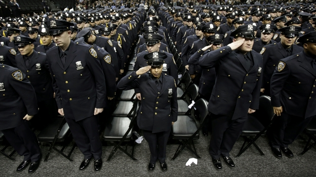 A New York City police academy graduation ceremony on Dec. 28, 2012, where Mayor Michael Bloomberg announced that the New York murder rate has hit an all-time low. While some point to the NYPD's policing tactics to explain the decline, others say economic and demographic shifts are also at work. (AP)