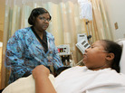 Nurse Corean McClinton, left, talks about pain management with Sherry Webb at the Sickle Cell Disease Center in the Truman Medical Center, in Kansas City, Mo., in 2007.
